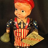 Vintage Occupied Japan tin and celluloid wind up toy NEWS BOY